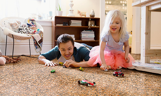 Father and daughter with toy cars